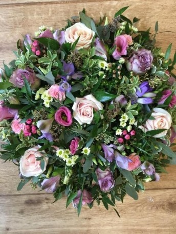 Pink and purple funeral posy